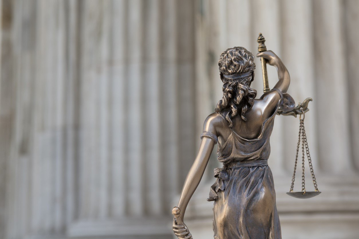 Blind Lady Justice with Back Turned